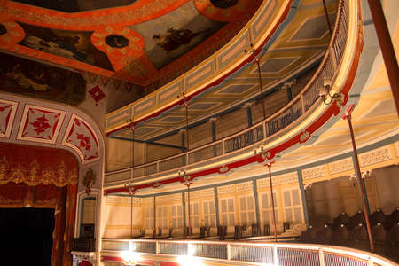 Balconies inside a theater, the nineteenth century, built of wood. Neoclassical style.