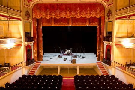 concert hall: Scenario of an ancient theater, just before the musical performance. Inside a theater, the nineteenth century, built of wood.