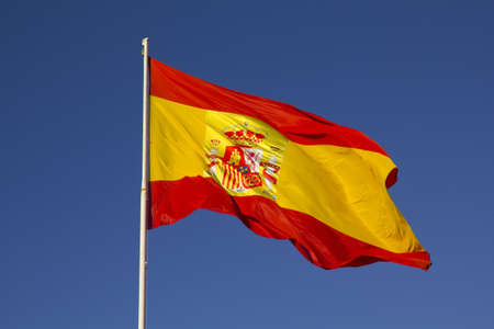 Spanish flag on a pole, undulating in the wind photo