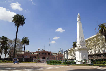 aires: The Plaza de Mayo ((English: May Square) is the main square in Buenos Aires, Argentina. In the background, the Casa Rosada (Pink House). The Pir�mide de Mayo can be seen in the right.