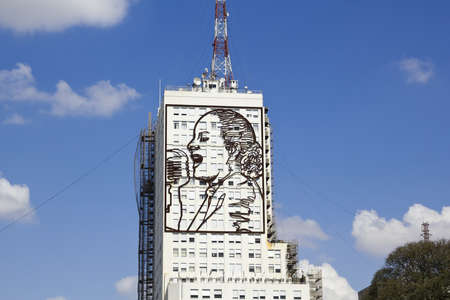 evita: Skyscraper with homage to Evita Peron, on Avenida 9 de Julio in Buenos Aires, Argentina  Photo taken on september 12, 2012  Buenos Aires, Argentina    Editorial