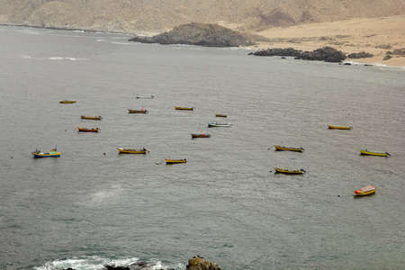 azucar: Fishing fleet in the Pacific Ocean  La Caleta of Pan de azucar National Park, Northern Chile  Stock Photo