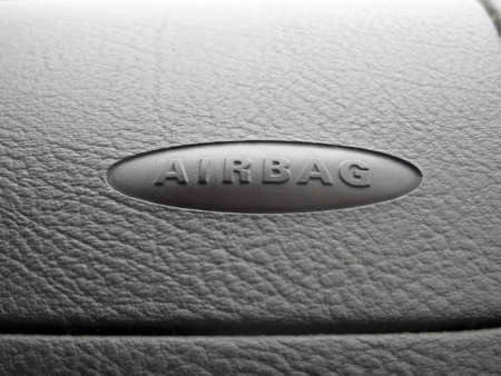 airbag: Macro of an airbag sign on a dashboard  Photo with copyspace