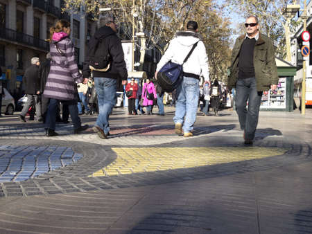 BARCELONA - DECEMBER 7  Tourists strolling famous Ramblas on December 7, 2012 in Barcelona  Rambla boulevard is one of the most recognized streets in the world