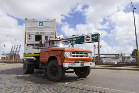 URUGUAY - SEPTEMBER 25  A loaded truck leaves Port on September 25, 2012 in Montevideo, Uruguay  It is one of the largest ports of South America and an important transit area for loads of Mercosur
