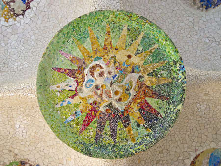 guell: Ceiling with mosaic sun of Park Guell designed by Antonio Gaudi in Barcelona, Spain