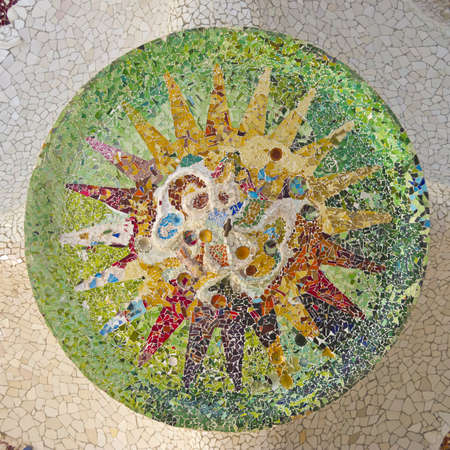 Ceiling with mosaic sun of Park Guell designed by Antonio Gaudi in Barcelona, Spain Stock Photo - 17225824