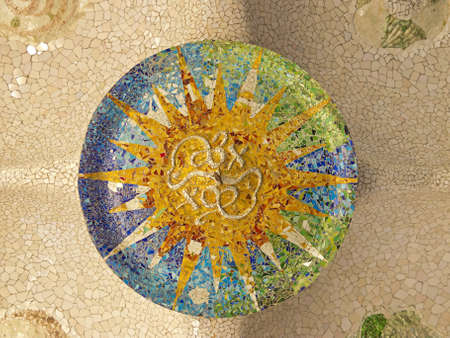 Ceiling with mosaic sun of Park Guell designed by Antonio Gaudi in Barcelona, Spain  photo