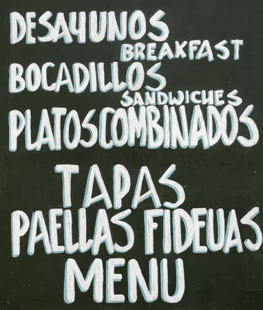 Typical spanish table of Tapas, Paellas, Menu photo