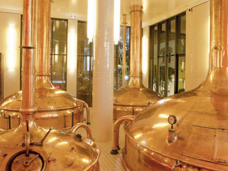 Antique Beer Factory. Old style of brewing beer.BARCELONA - NOVEMBER 29: Former brewery on November 29, 2012 in Barcelona. Damm brewery was founded in 1876, one of the oldest in Spain. Stock Photo - 17523306