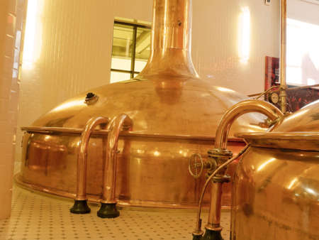 Antique Beer Factory. Old style of brewing beer.BARCELONA - NOVEMBER 29: Former brewery on November 29, 2012 in Barcelona. Damm brewery was founded in 1876, one of the oldest in Spain. Stock Photo - 17523305