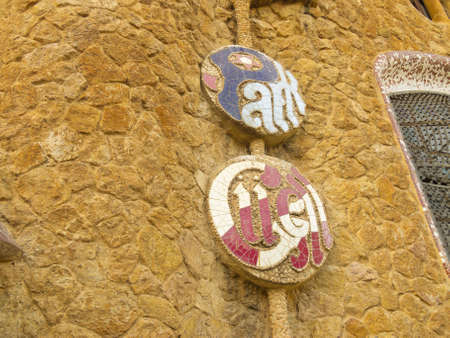 Placard of Park Guell designed by Antonio Gaudi on December 27, 2012 in Barcelona.