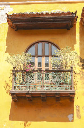 colonial house: Cartagena - the colonial city in Colombia is a beautifllly set city, packed with historical monuments and architectural treasures  The picture present facade of the colonial house with balconies Stock Photo