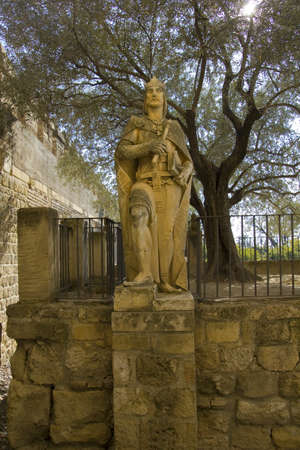 patrimony: Statue of King Alfonso X or Fernando III, next to the Tower of the Lions  Alcazar od Cordoba  Spain  Stock Photo