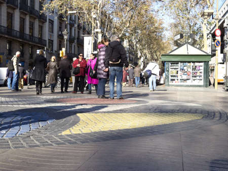 the ramblas: BARCELONA - DECEMBER 7: Tourists strolling famous Ramblas on December 7, 2012 in Barcelona. Rambla boulevard is one of the most recognized streets in the world.
