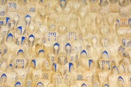 Canopy with stonework. Arabesques made with Arabic calligraphy. Hall of the two Sisters. Alhambra, Andalusia, Spain.