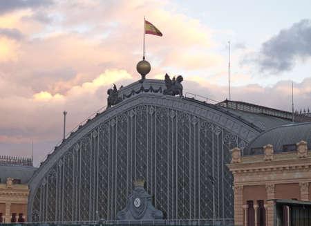 railway history: sunset in Madrid . Puerta de Atocha station in Madrid, capital of Spain.