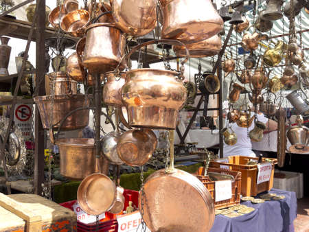 Selling old copper cookware  San Telmo market in Buenos Aires, Argentina  photo