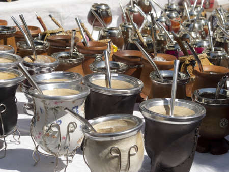 mate drink: Group of calabash mate cups with straws in Buenos Aires  Mate is a traditional drink very similar to tea in Argentina, Uruguay, Paraguay and Brazil