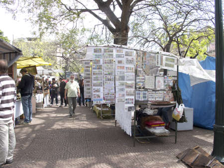 BUENOS AIRES, - SEP 30: Street market in Plaza Dorrego in San Telmo district, Buenos Aires on September 30, 2012. The city is a popular tourist destination, with more than 2.5 million visitors a year.
