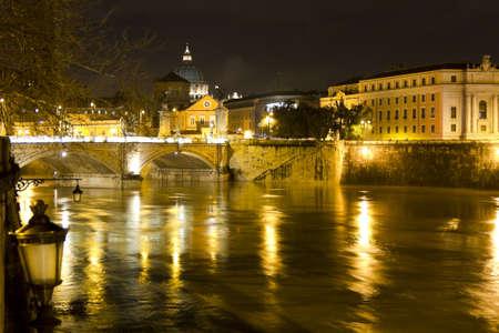 tevere: Tiber river, Vittorio Emanuele bridge and Dome of St  Peter in the Vatican city  Stock Photo