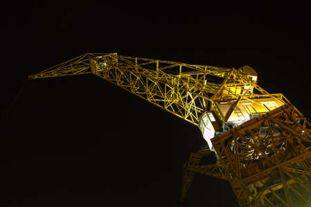 Port crane iluminated by night  photo