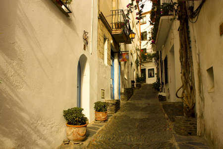 Dawn  Narrow street in a small Mediterranean village  Cadaques, Costa Brava, Catalonia, Spain photo