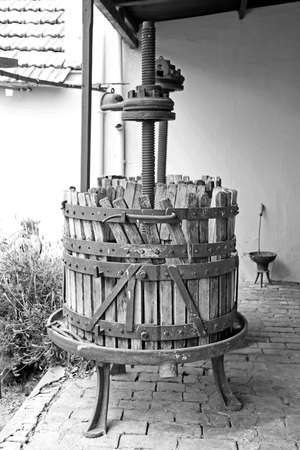 old wooden wine press for pressing grapes to produce wine photo