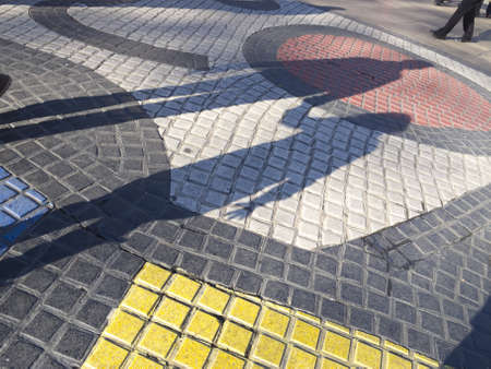 Miros mosaic in the middle of the Rambla, the most important road in Barcelona, one of the landmarks of the city. Barcelona, Catalonia, Spain photo