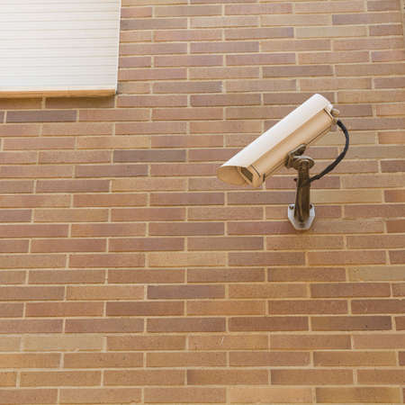 security camera on a wall photo