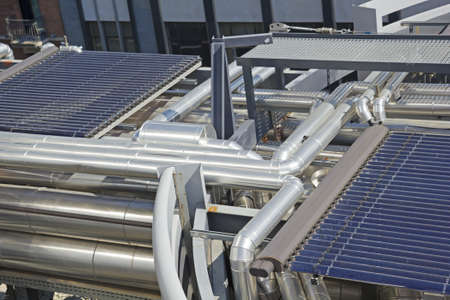 eco building: Solar vacuum tube  Integrated energy system of a building  Stock Photo