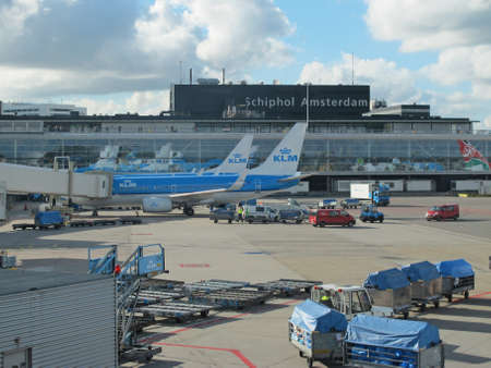 AMSTERDAM - OCT 6  KLM plane being loaded at Schiphol Airport on October 6, 2012 in Amsterdam, Netherlands  There are 163 destinations served by KLM, many are located in the Americas, Asia and Africa