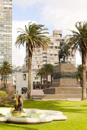 artigas: Independence Square, the main square in Montevideo, with the equestrian statue of Jose Gervasio Artigas. Behind the Gate of the Citadel, Executive Tower (government) & Palacio Estevez. Uruguay. Editorial
