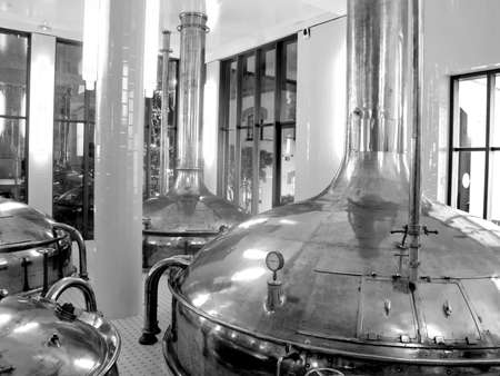 brew house: Antique Beer Factory  Old style of brewing beer  Monochrome photography   BARCELONA - NOVEMBER 29  Former brewery on November 29, 2012 in Barcelona  Damm brewery was founded in 1876, one of the oldest in Spain  Editorial