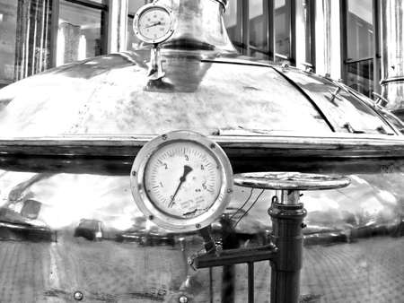 Temperature Gauge  Old style of brewing beer  Monochrome photography   BARCELONA - NOVEMBER 29  Former brewery on November 29, 2012 in Barcelona  Damm brewery was founded in 1876, one of the oldest in Spain