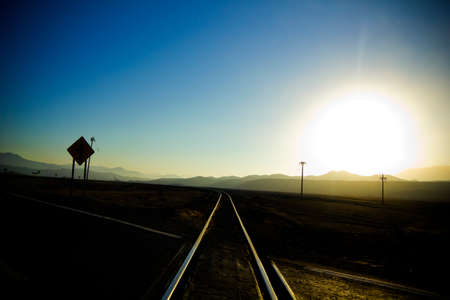 Crossing railroad tracks, sunset in the Andes, Atacama, Chile  photo