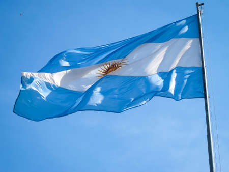 Argentina flag on a pole, with the Inca sun in the middle  Stock Photo