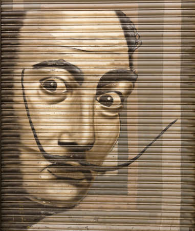 Tribute to Salvador Dali in a metal shutter on Aug 21, 2013 in Barcelona, Spain  The Catalan painter is considered one of the greatest representatives of surrealism