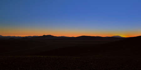 Sunset in the Atacama Desert  Silhouette of the mountains as the sun goes down  Atacama, Chile  photo