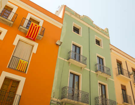 separatist: Balconies in Catalonia with the flag of independence. Figueres, Catalonia.  Stock Photo