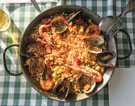 a traditional: Typical spanish seafood paella in traditional pan