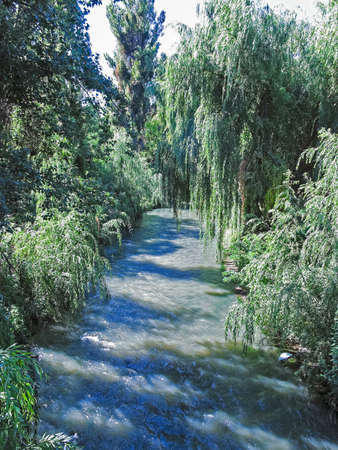 Maule river as it passes through the city of Talca, Chile photo