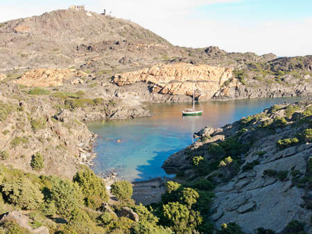 Boats on mediterranean bay. The Cap de Creus, a natural park, is ideal for excursions on foot or by boat. Situated in the northern Costa Brava, Girona province, Catalonia, Spain. photo