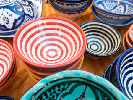 spanish ethnicity: Moroccan ceramic sale in outdoor market Stock Photo