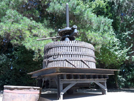 wine industry: Ancient wine press. Traditional old technique of winemaking. The Chilean wine industry is the 7th world producer and the biggest exporter of South America.