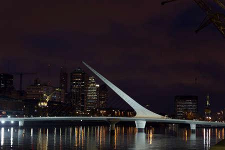comercial: Woman s Bridge is a footbridge in Puerto Madero comercial district of Buenos Aires, Argentina.
