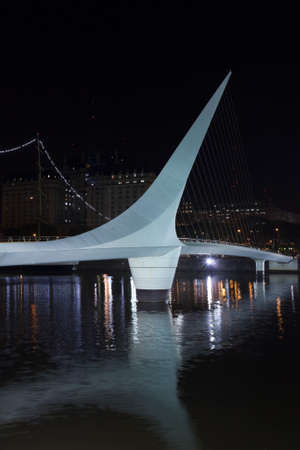 comercial: Woman s Bridge is a footbridge in Puerto Madero comercial district of Buenos Aires, Argentina.