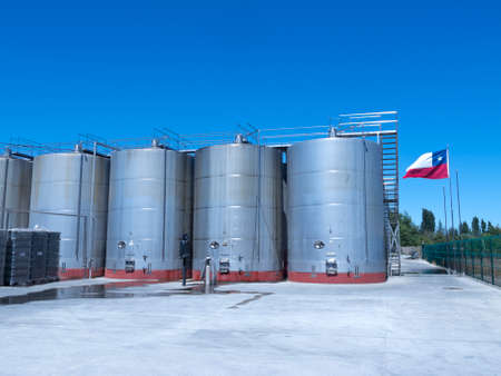 exporter: Some wine metallic fermentation tanks. Wine industry in Chile.  The Chilean wine industry is the 7th world producer and the biggest exporter of South America.