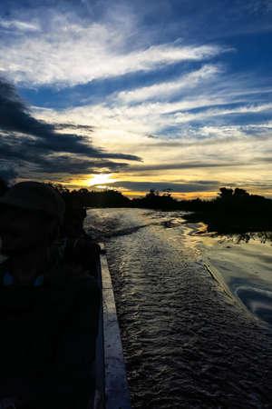 amazonas: Sunset. Boat Crossing the Amazon.  Beni region Pampas de Yacuma Bolivia. Stock Photo