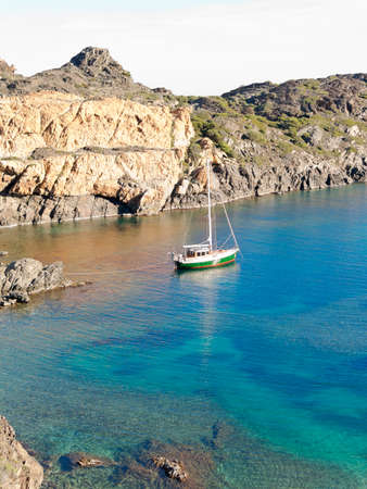 excursions: Boats on mediterranean bay. The Cap de Creus, a natural park, is ideal for excursions on foot or by boat. Situated in the northern Costa Brava, Girona province, Catalonia, Spain.